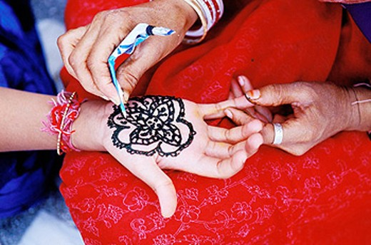 Tattoing hands with henna. Rajasthan. India : Stock Photo