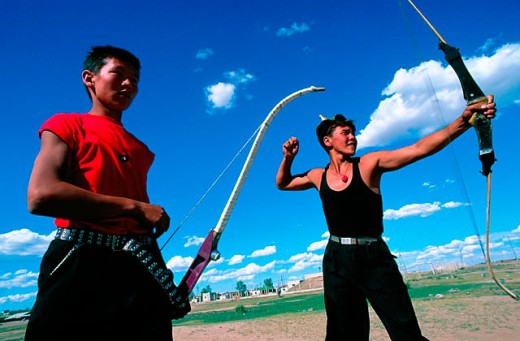 Stock Photo: 1566-0107173 Archers contesting at the ´Three Games of Men´. Naadam festival. Ondorkhaan. Khenti. Mongolia