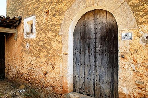Traditional door made of sandstone. Majorca. Balearic Islands. Spain : Stock Photo