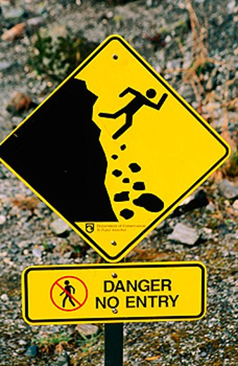 Stock Photo: 1566-0117997 Fallin rock or avalanche warning sign. Fox Glacier. South Island. New Zealand