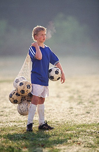 Boy with soccer balls : Stock Photo