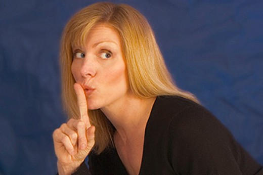 Stock Photo: 1566-0118894 Woman gesturing to keep quiet