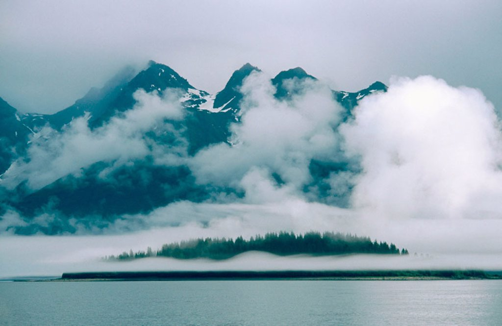 Stock Photo: 1566-0119658 Clouds over the mountains. Glacier Bay. Glacier Bay National Park. Alaska. USA