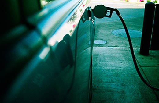 Car filling up with gasoline : Stock Photo