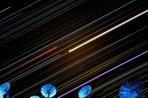 Stock Photo: 1566-0120380 Satellites and star trails in the night sky