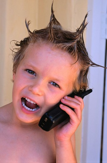 Boy, 4 years old, with cell phone : Stock Photo