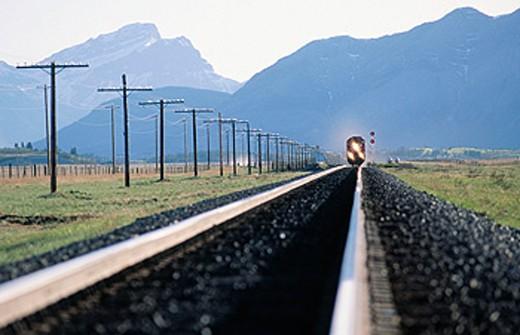 Stock Photo: 1566-0123104 Train on tracks. Alberta. Canada
