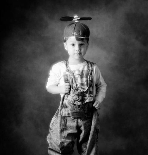 Boy wearing propellor beanie cap : Stock Photo