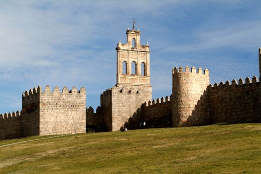 Bell gable of Convento del Carmen and medieval walls of Ávila, the best preserved ones in Spain. They date from 1090, with 2,5 km long, 88 towers and 6 gates. Ávila (city added to the Unesco´s World Heritage List in 1985). Spain : Stock Photo