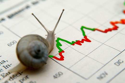 Stock Photo: 1566-0129983 Common garden snails (Helix aspersa) over financial information