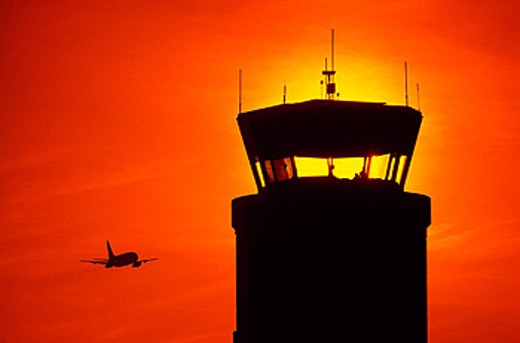Stock Photo: 1566-0130371 Airport control tower and plane taking off