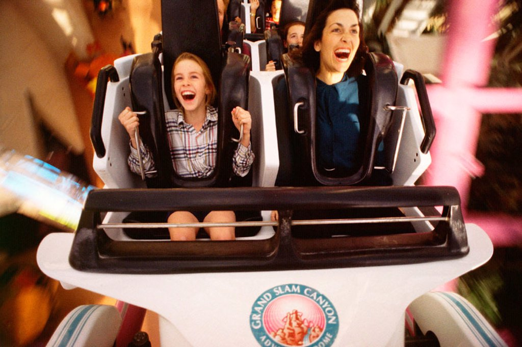 Mother and daughter on roller coaster : Stock Photo