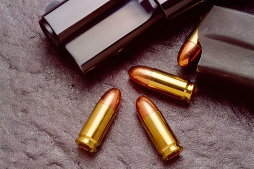Pistol and bullets : Stock Photo