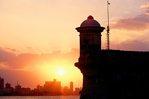Stock Photo: 1566-0130912 Fortress of El Morro at sunset and Havana in background. Cuba