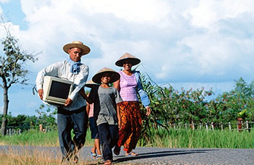 Stock Photo: 1566-0131201 A family walking in the village of Prah Dah. Province of Siem Reap. Cambodia