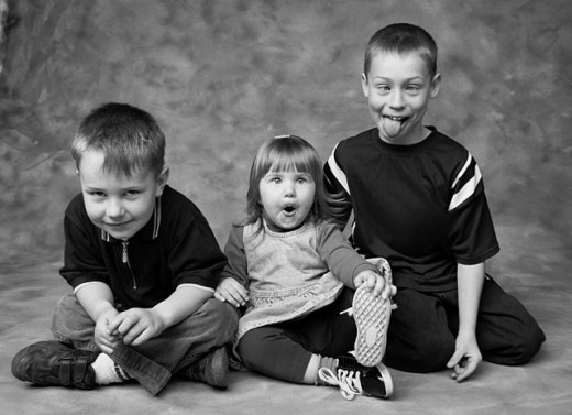 Children making faces : Stock Photo