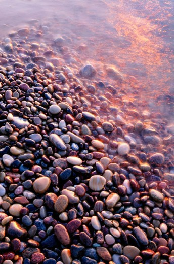 Colorfull rubble stones at waters edge, by the Baltic Sea. East coast of Skåne, Sweden. : Stock Photo