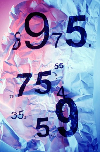 Random numbers printed on crumpled paper : Stock Photo