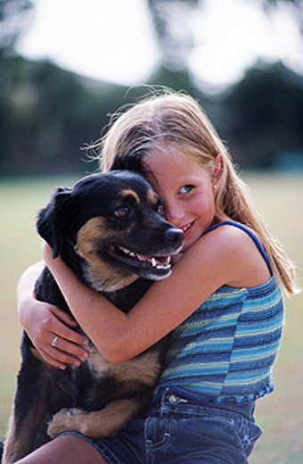 Girl with dog : Stock Photo