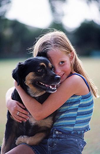 Stock Photo: 1566-0136478 Girl with dog