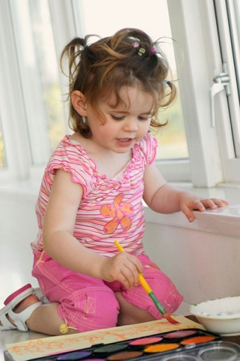 Little girl painting : Stock Photo