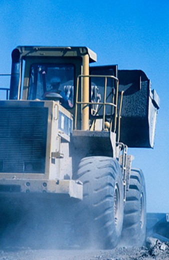 Loader in motion. I-880 Cypress Project. Oakland, California. USA. : Stock Photo