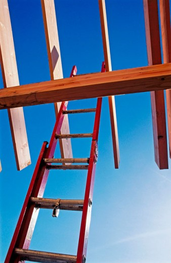 Stock Photo: 1566-0142456 Ladder and roof framing residential single family house.