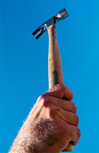 Stock Photo: 1566-0142500 Hammer and arm.
