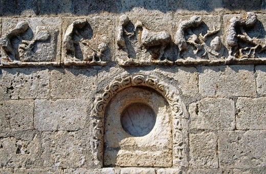 Frieze representing calendar of agricultural tasks of romanesque church of San Bartolomé (13th century). Campisabalos. Sierra de Ayllon. Guadalajara province. Castilla-La Mancha. Spain : Stock Photo