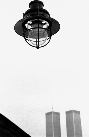 Stock Photo: 1566-0147086 Lamp and top of the World Trade Center twin towers. Manhattan. New York City. USA