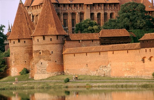 Stock Photo: 1566-0147930 Europe´s largest gothic castle (13th century), residence of Teutonic Knights´ grand master, beside the Vistula River Delta known as the Nogat. Malbork. Pomerania, Poland
