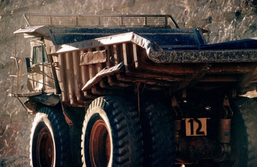 Ore-carrying truck in open-cut gold mine : Stock Photo
