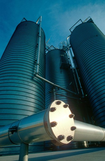 Storage tanks at petrochemical oil refinery : Stock Photo