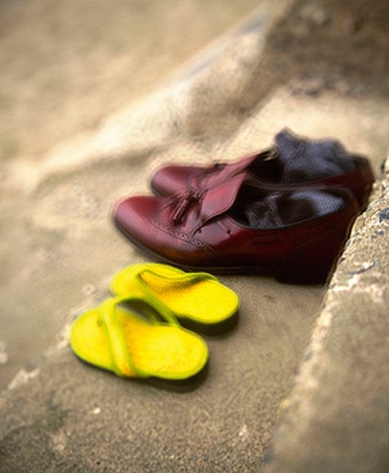 Stock Photo: 1566-0151663 Pair of shoes on steps in a beach of San Francisco. California. USA