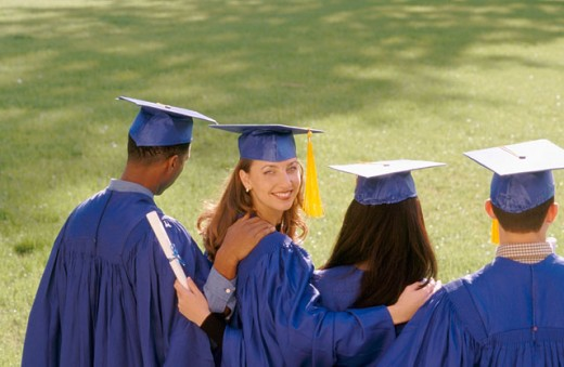 Stock Photo: 1566-0153005 Backview of college graduates with female graduate looking back over her shoulder