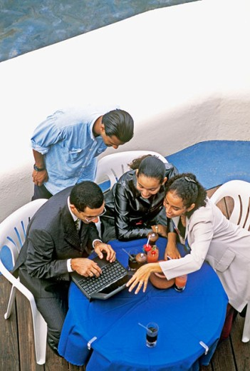 Stock Photo: 1566-0154169 Young employees in open air meeting, Curacao, Netherlands Antilles