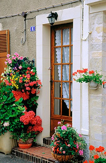 Stock Photo: 1566-0157672 Home doorway and flowers. Normandy. France