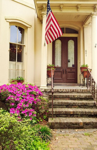 Stock Photo: 1566-0157733 Azalea blossoms and Victorian home. Savannah. Georgia. USA