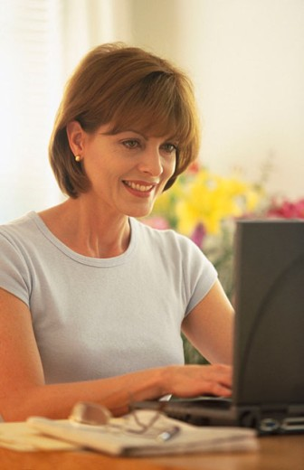 woman using her laptop : Stock Photo