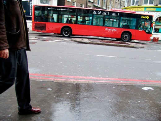 A street in Southmark section of London. A bus in the street and a man entering the frame. England : Stock Photo