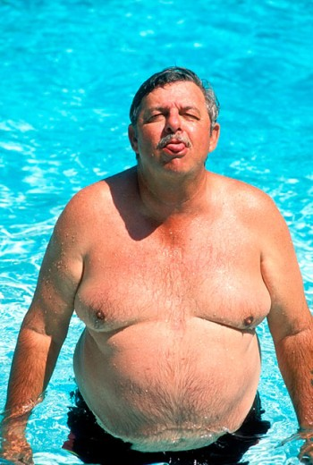 big man in pool : Stock Photo