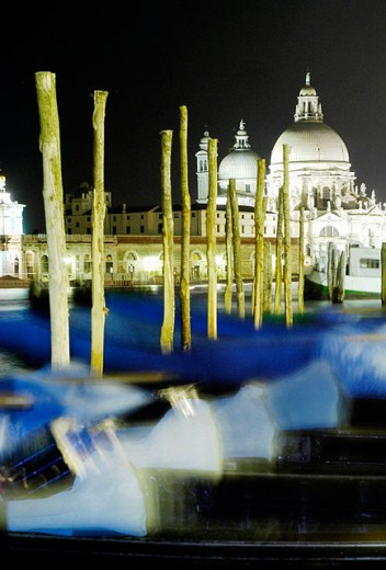 Gondolas at St. Mark´s pier with Santa Maria della Salute church in background at night. Venice. Italy : Stock Photo