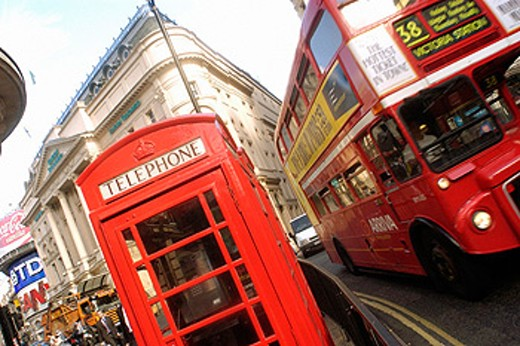 Red telephone booth and red double-decker bus. London. England : Stock Photo