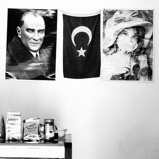 Stock Photo: 1566-0165216 Portrait of Atatürk, Turkish flag and little girl poster in restaurant. Turkey