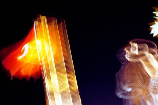 Stock Photo: 1566-0165223 Statue of Atatürk and Turkish flag at night. Kas. Turkey