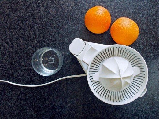 Orange and squeezer : Stock Photo