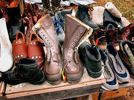 Used shoes for sale at public flea market : Stock Photo