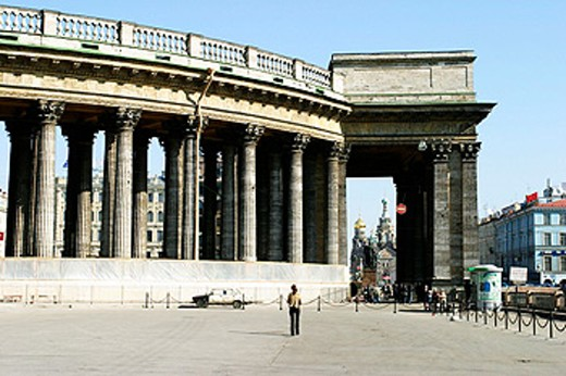 Stock Photo: 1566-0172005 Stone colonnade of The Kazan Cathedral (Kazanskii Sobor) at Nevskii Prospekt, St. Petersburg, Russia. In background Church of Our Savior on the Spilled Blood.