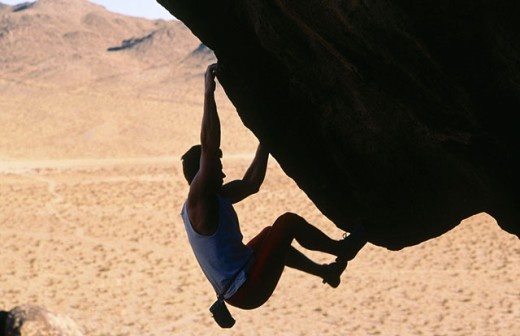 Stock Photo: 1566-017345 Rock climbing in California desert