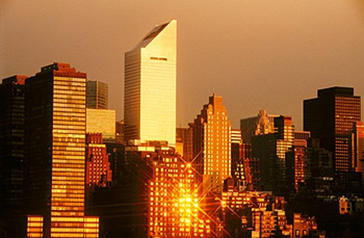 Sun reflecting of buildings in Midtown Manhattan. New York City, USA : Stock Photo